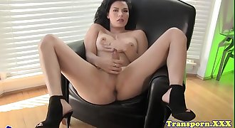 Classy tgirl with bigtits wanking on her hard-on